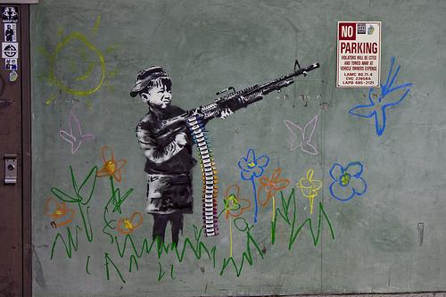 Banksy Crayola shooter Los Angeles kid with machine gun buenos aires street art